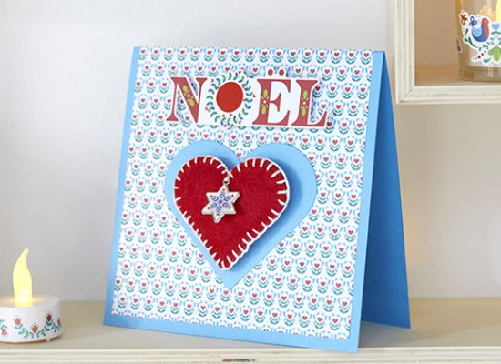carte Noël folk bleu rouge coeur