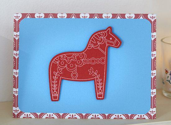 carte voeux Noël cheval rouge bleu